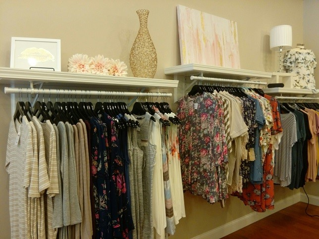 Racks of clothing and home accessories inside 3 jems boutique.