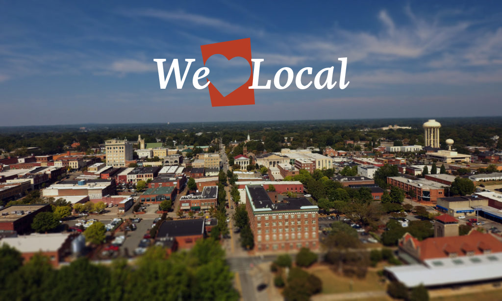 aerial photo of downtown salisbury with words We heart local