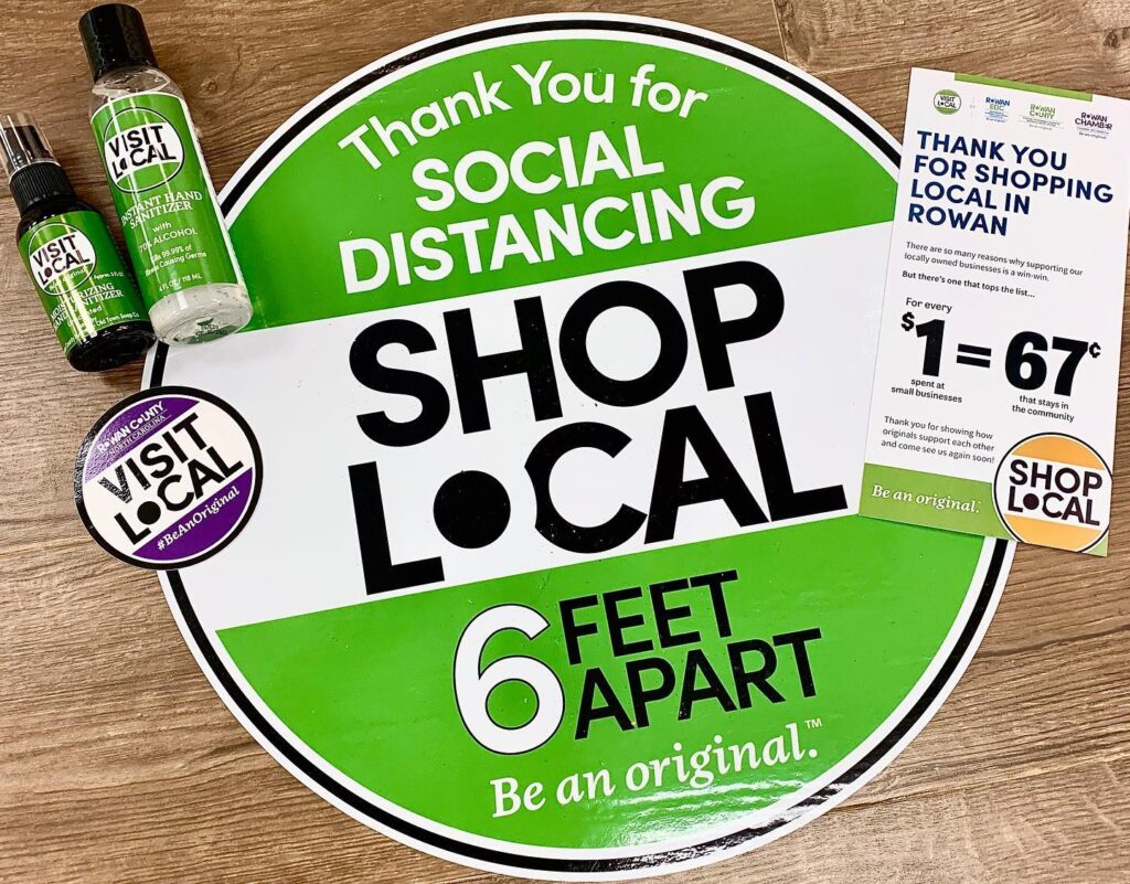 "Selection of shop local signs and stickers that say ""Thank you for shopping local - stay 6 feet apart."""